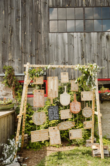 Cutting board seating chart for a farm to table barn wedding