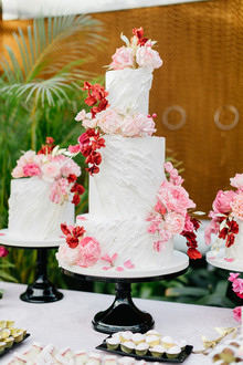 Ruffled floral wedding cake with pink details
