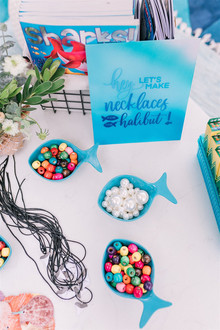 Sharks and mermaids joint birthday pool party
