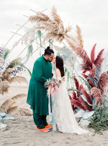 Dyed floral ceremony arch
