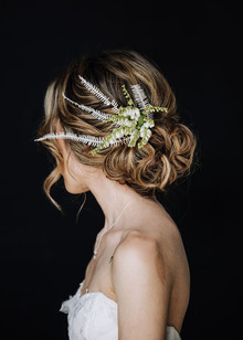 Bridal updo with greenery