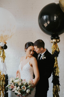 Black and gold tassel balloons