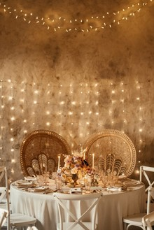 sweetheart table with lighting backdrop