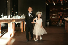 Flower girl walking down aisle