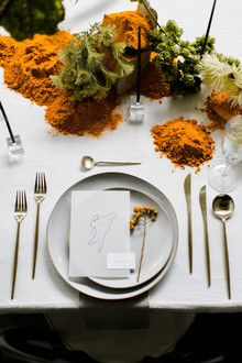 turmeric and white place setting