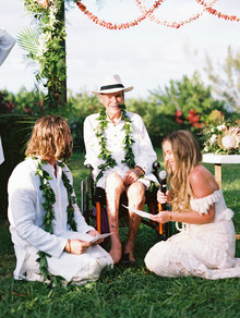 Ram Dass officiated this couple's bohemian Maui wedding