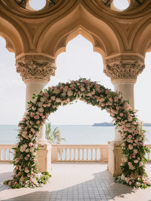 pink floral arch for ceremony