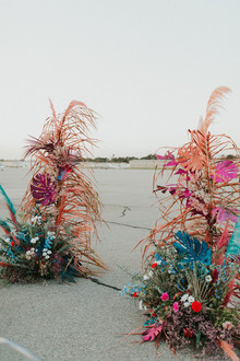 colorful ceremony flowers with feathers