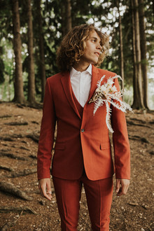 rust colored groom's suit