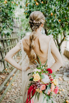bridal ponytail and tropical bouquet