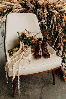boho wedding bouquet and boots