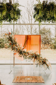 lush modern boho wedding ceremony floral installation