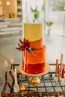orange wedding cake for desert inspired wedding