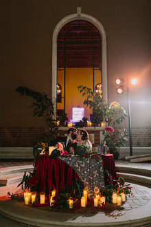 dramatic sweetheart table with candles