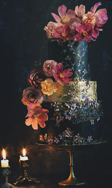 black wedding cake with flowers