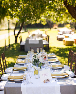 Sunny outdoor seating with yellow napkins