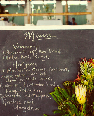 Chalkboard dinner menu with greenery