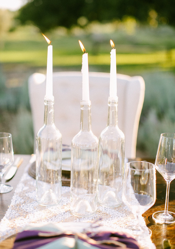 Clear vases with white candles