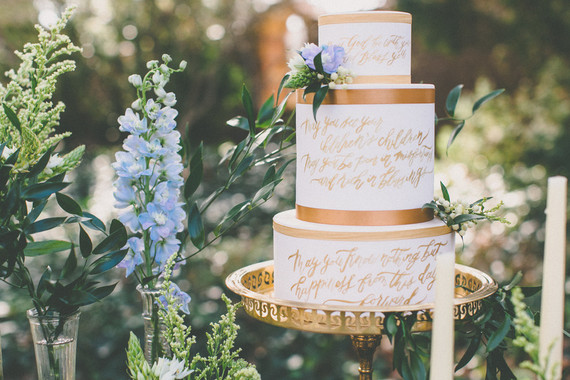 Gold calligraphy wedding cake