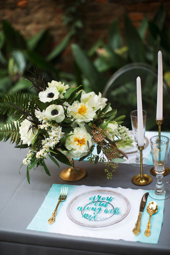 Aqua and gold modern place setting with florals