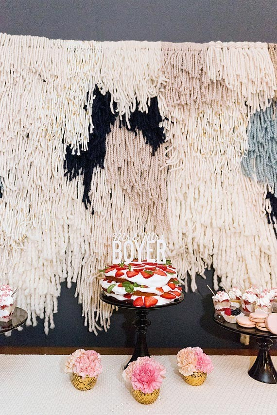 Dessert table with fringe backdrop
