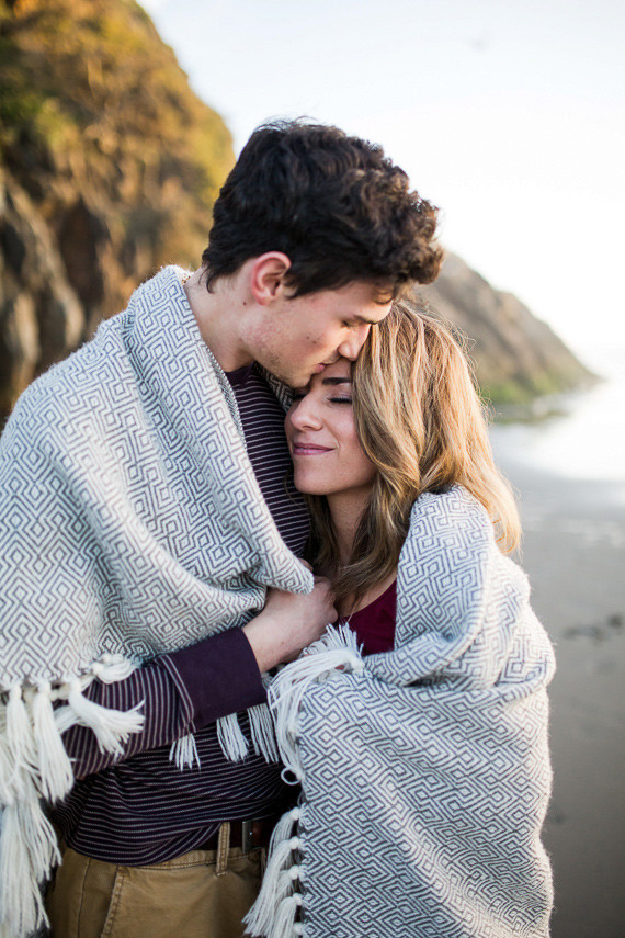 Beach blanket engagement photo