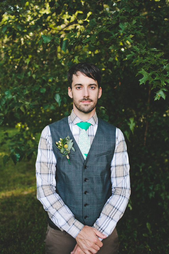 Groom with grey vest and striped shirt