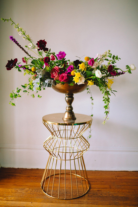 Colorful centerpiece with gold base wedding party