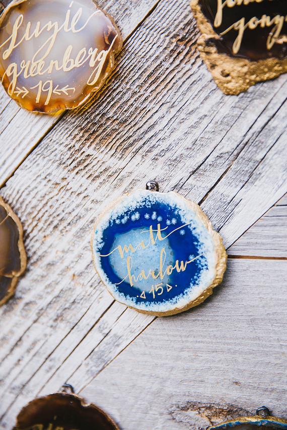 Gold calligraphy escort card