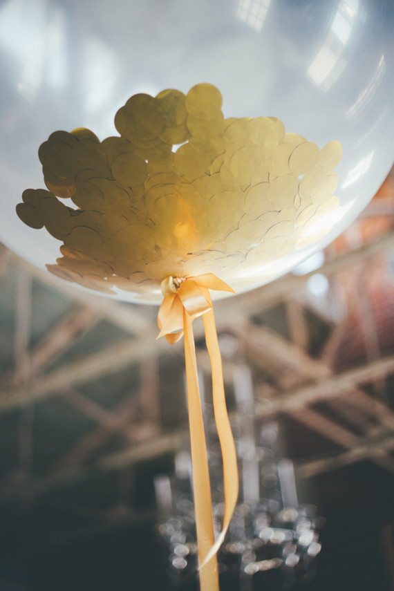 clear balloon with gold confetti