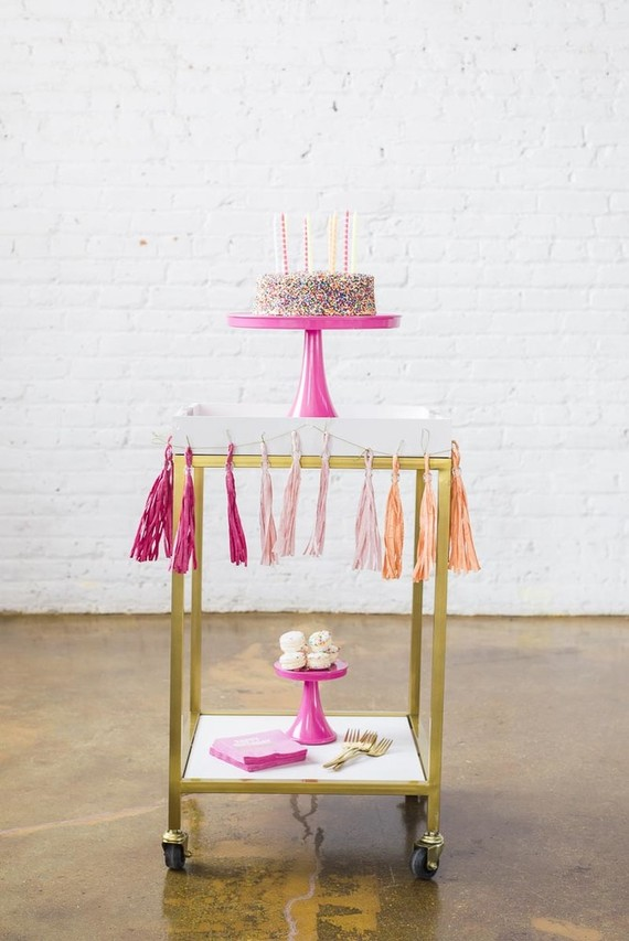 sprinkles birthday cake on a bar cart