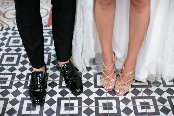 black and white tile with stylish wedding shoes