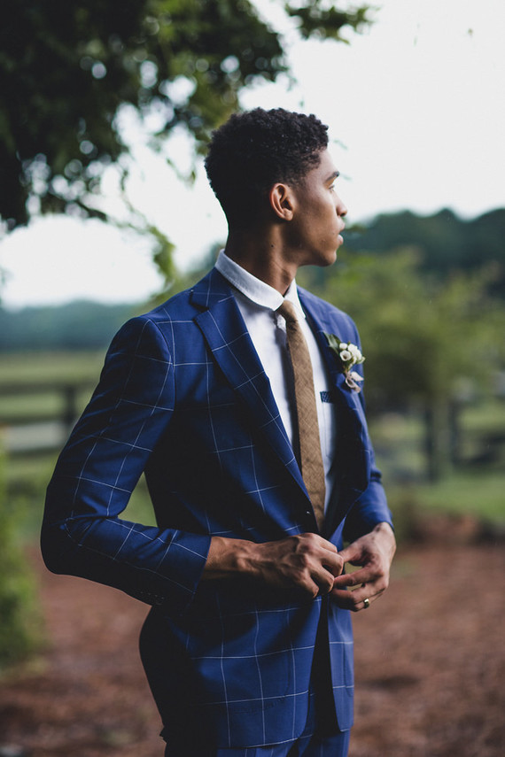Stylish groom in a blue suit