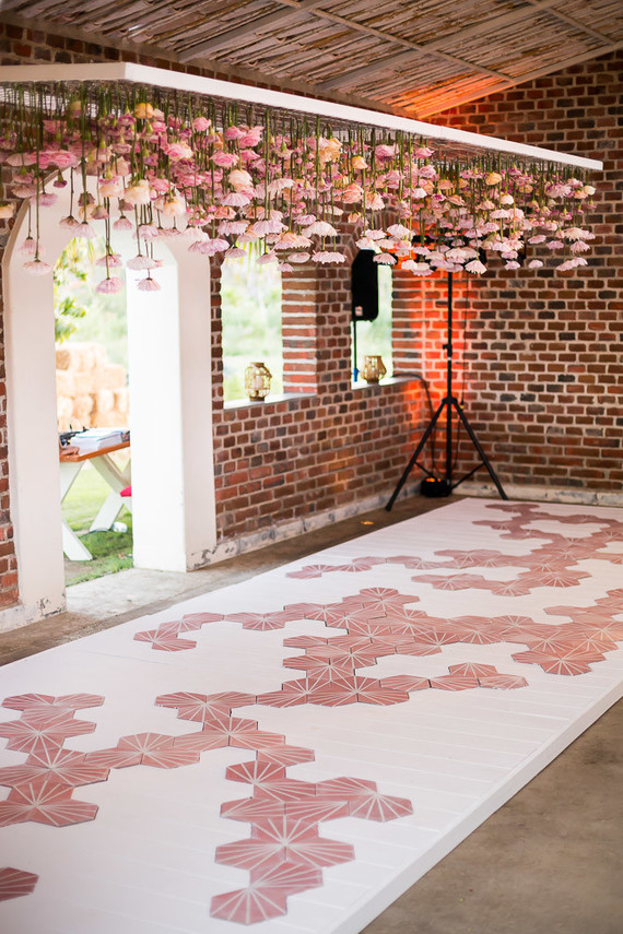 hanging flowers above dance floor