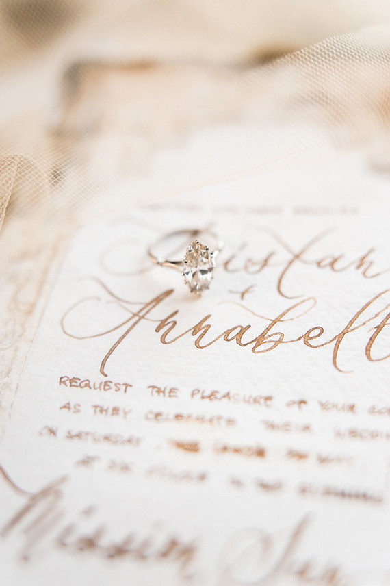 romantic calligraphy and engagement ring