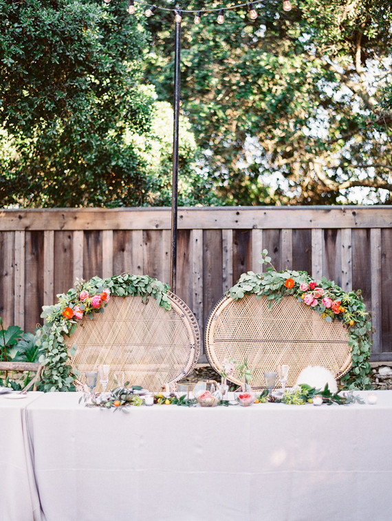 Sweetheart table with boho rattan chairs