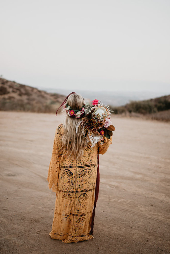 Boho vow renewal with a palm frond teepee at Wolf Feather Honey Farm