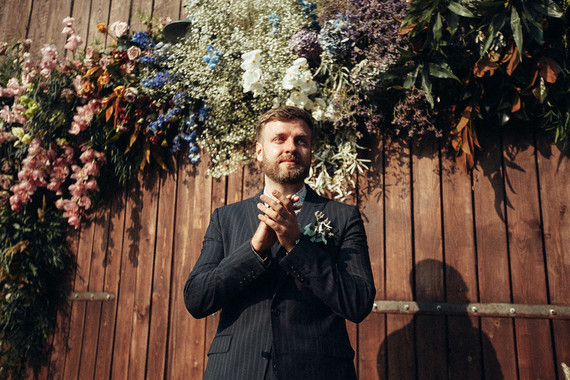 Rustic groom at ceremony