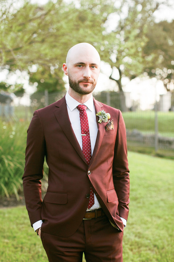 Burgundy groom's suit