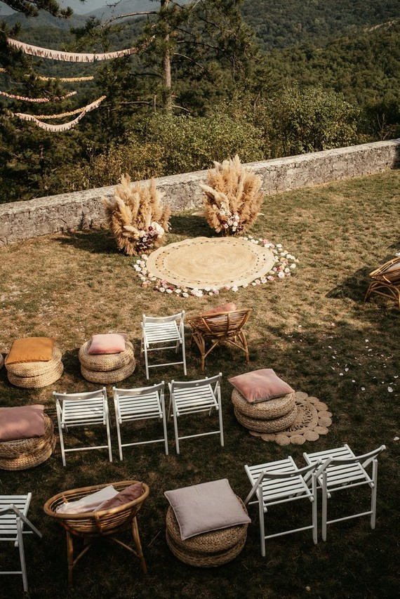 Modern bohemian wedding ceremony with pampas grass