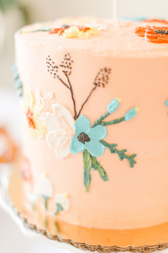floral peach 1st birthday cake