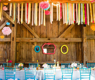 Cheerful Multi Colored Poms and Streamers Reception Decor