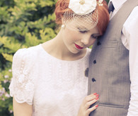 Bridal floral headpiece detail and lace dress