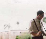 Suspender wearing groom detail