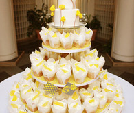 Yellow colored cupcake tower