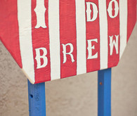 Whimsical world circus i do brew sign