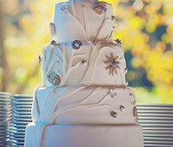 Beautiful contoured cake with bird toppers