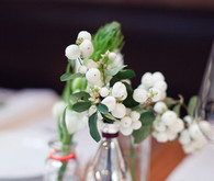 DIY floral centerpieces in glass bottles