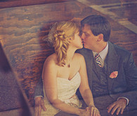 Rustic couple kissing portrait