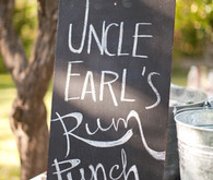 Chalkboard 'uncle earl's rum punch' sign